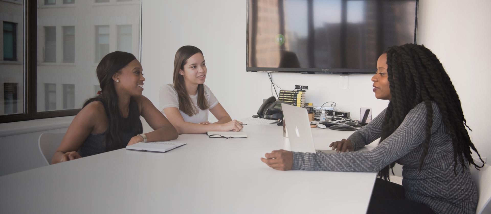 3 women having a meeting