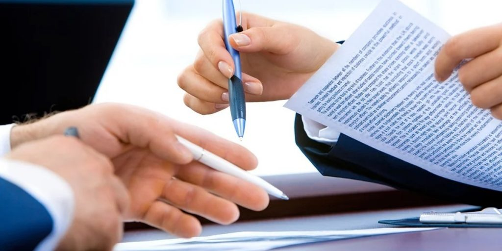 Two people with pens covering a disciplinary hearing